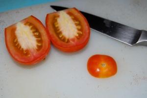 Slice tomato in half