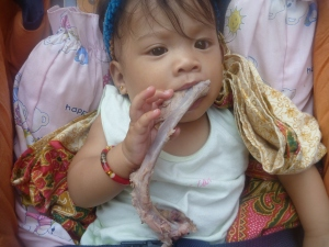 baby eating lechon rib